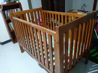 A baby cot with matress for sale